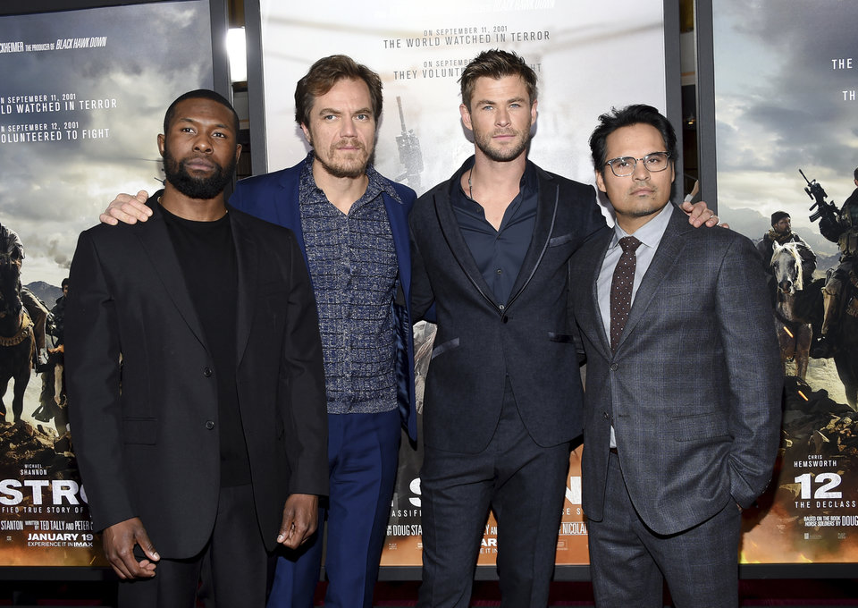 "Actors Trevante Rhodes, from left, Michael Shannon, Chris Hemsworth and Michael Pena pose at the world premiere of ""12 Strong"" at Jazz at Lincoln Center Frederick P. Rose Hall on Tuesday, Jan. 16, 2018, in New York. (Photo by Evan Agostini/Invision/AP)"