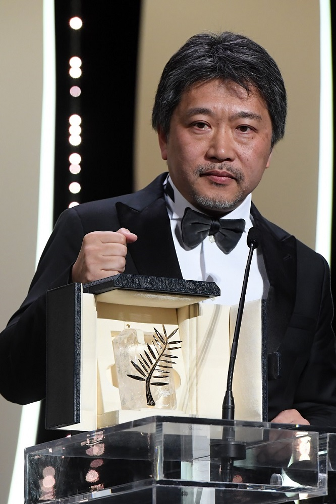 CANNES, FRANCE - MAY 19: Director Hirokazu Koreeda receives the Palme d'Or award for 'Shoplifters' (Manbiki Kazoku) on stage during the Closing Ceremony at the 71st annual Cannes Film Festival at Palais des Festivals on May 19, 2018 in Cannes, France. (Photo by Stephane Cardinale - Corbis/Corbis via Getty Images) *** Local Caption *** Hirokazu Koreeda