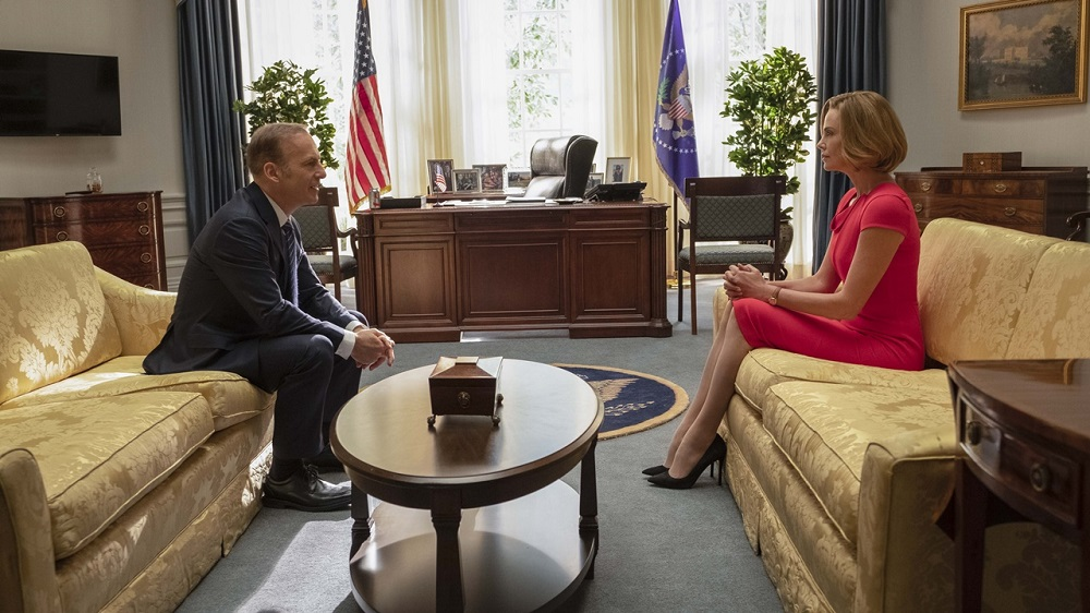 President Chambers (Bob Odenkirk) and Charlotte (Charlize Theron) in LONG SHOT.